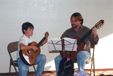 Student taking a guitar lesson with Craig Devine