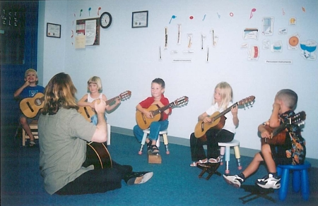 Craig Devine teaching kindergarten guitar class